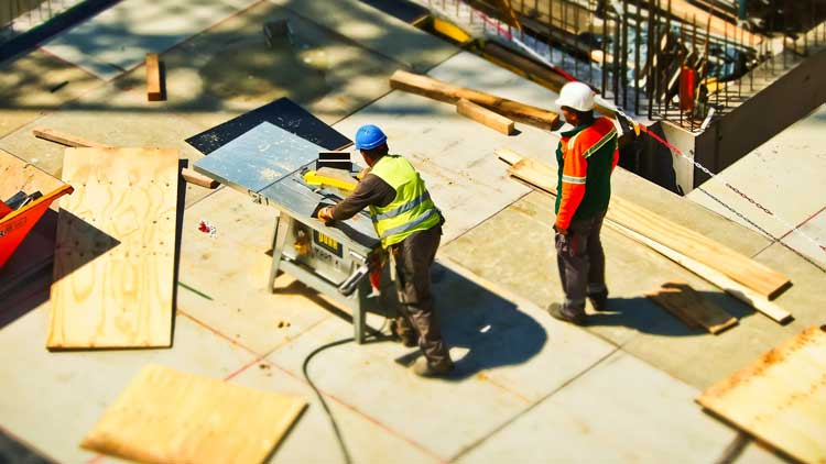 Men working on roofing Construction